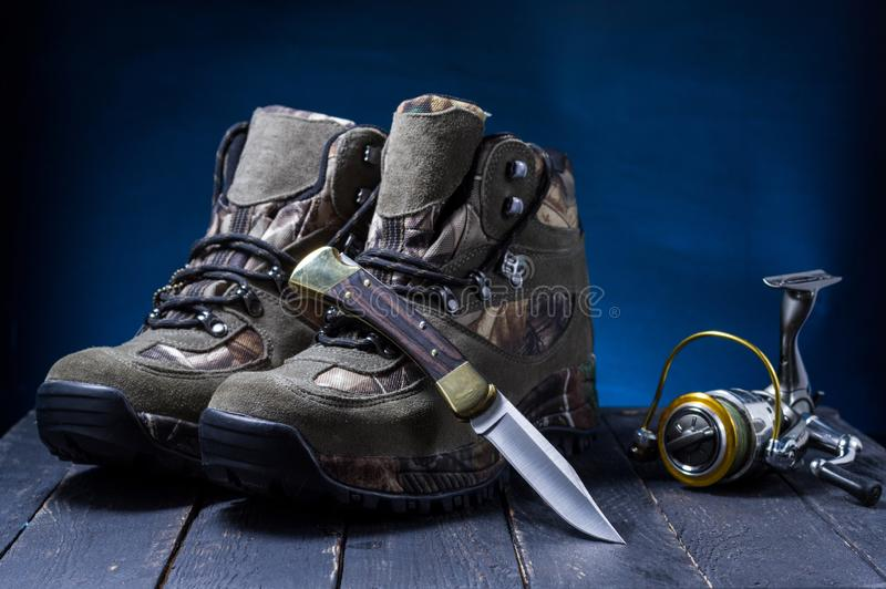 Fishing hunting composition. Fisherman hunter. Hunting fishing subjects royalty free stock images
