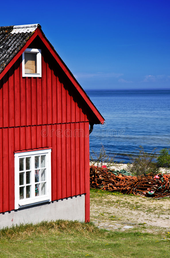 Fishing hut. Red fishing hut with nets on the coast (Sweden royalty free stock photography