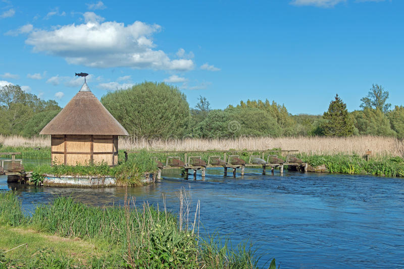 Fishing hut on the River test stock image