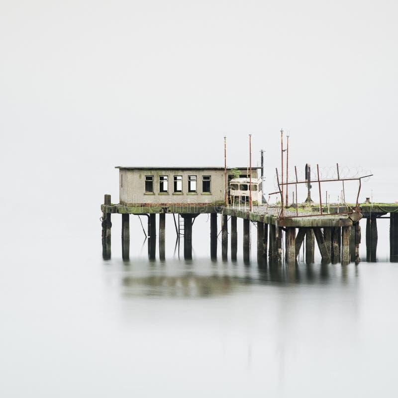 Fishing hut Thailand pier jetty sticks in fog mist silhouette sea coastal dock stock image