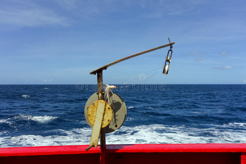 Fishing from an inter-island passenger ferry in the windward islands. A fishing line and lure at the stern of a passenger ship en route to st. vincent royalty free stock photography