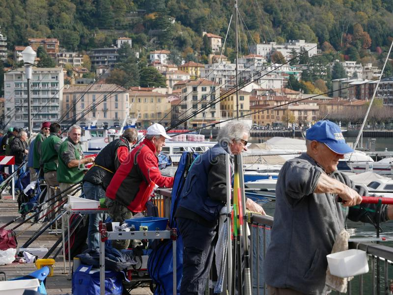 Men in a fishing competition at Lake Como, Italy royalty free stock photos