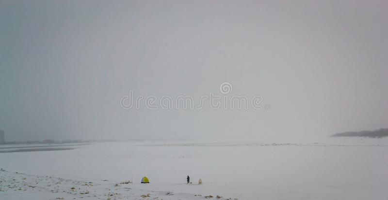 Fishing on a large river in winter stock photography