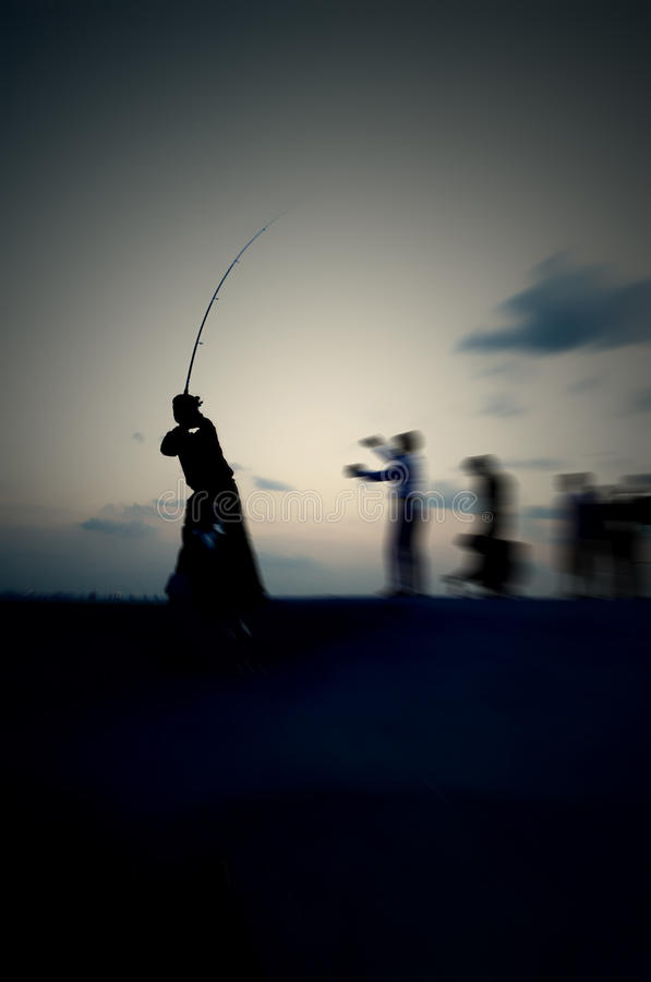 Fishing in the late evening stock image