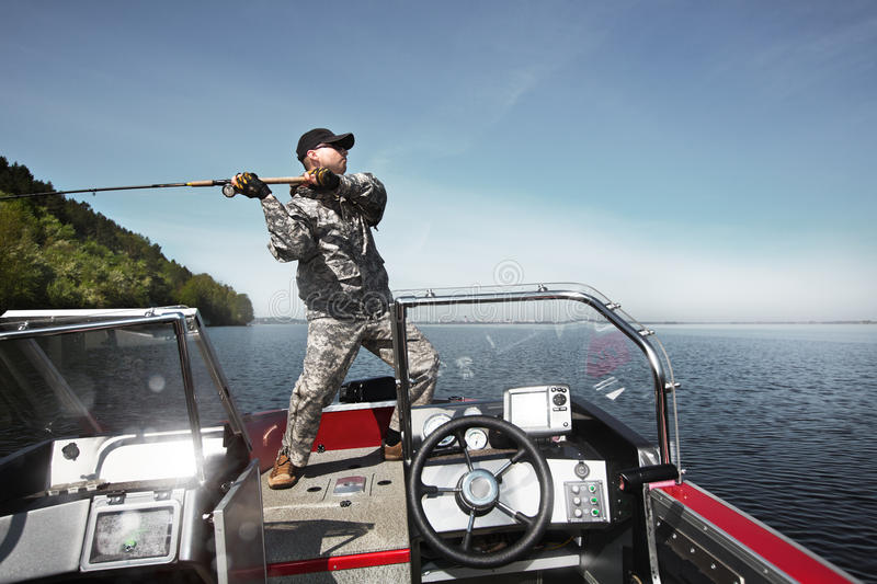 Fishing man in boat stock image