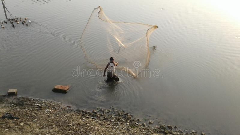 Fishing. A man fishing river and jessore in Bangladesh stock image