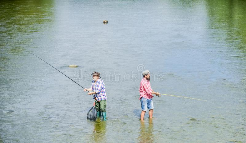 Fishing is much more than fish. Male friendship. Father and son fishing. Summer weekend. Happy fisherman with fishing royalty free stock images