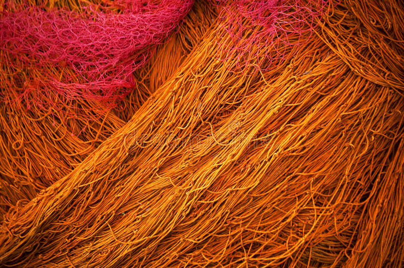 Fishing net. A coloured fishing net on a boat stock photos