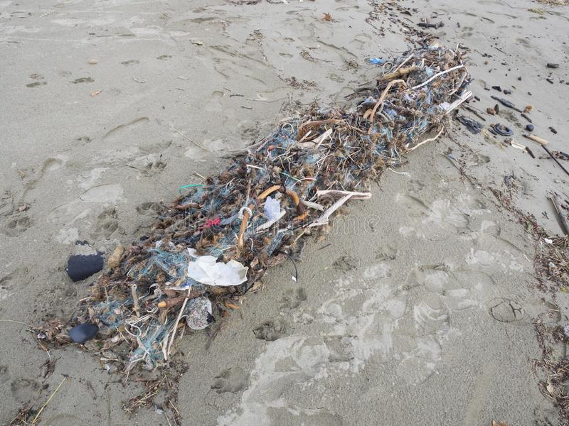 Fishing net full of plastic waste. Symbol fo ocean pollution. Fishing net arrived on the beach full of plastic waste. Symbol fo ocean pollution. Danger fo marine stock photo