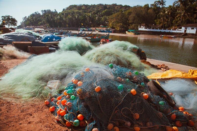Fishing net. And fishing boats with equipment. Baga beach. Goa-India stock image