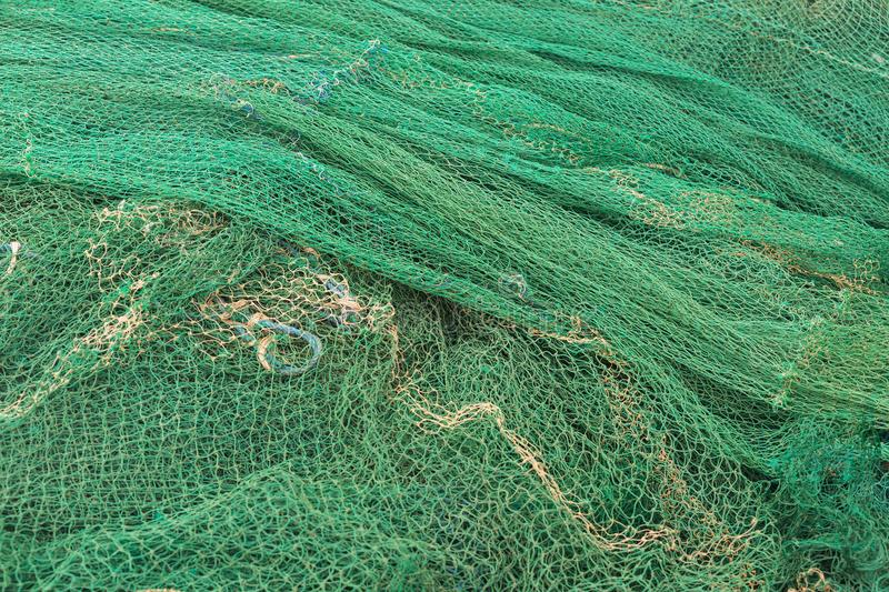 Fishing net closeup. Photo Knitted cages royalty free stock image