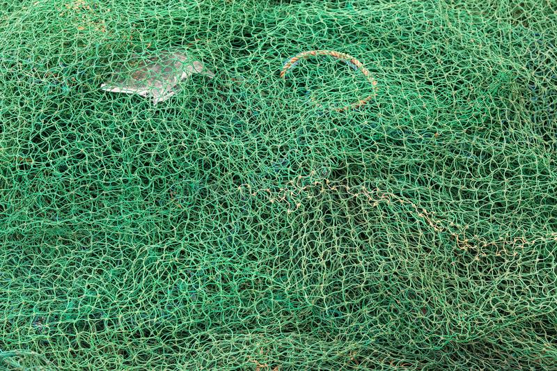 Fishing net closeup. Photo Knitted cages royalty free stock photography