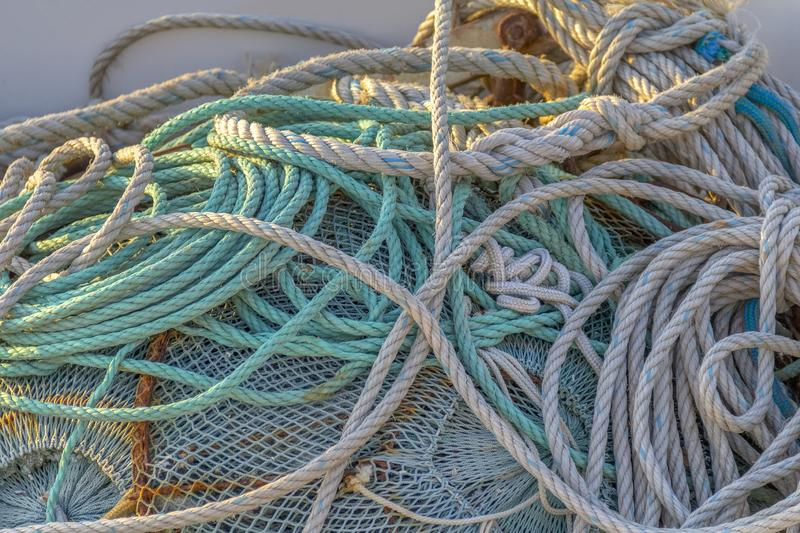 Fishing net entanglement. Full frame picture showing a tangled fishing net royalty free stock images