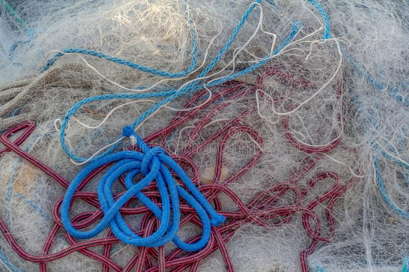 Fishing net entanglement. Full frame picture showing a tangled fishing net stock image