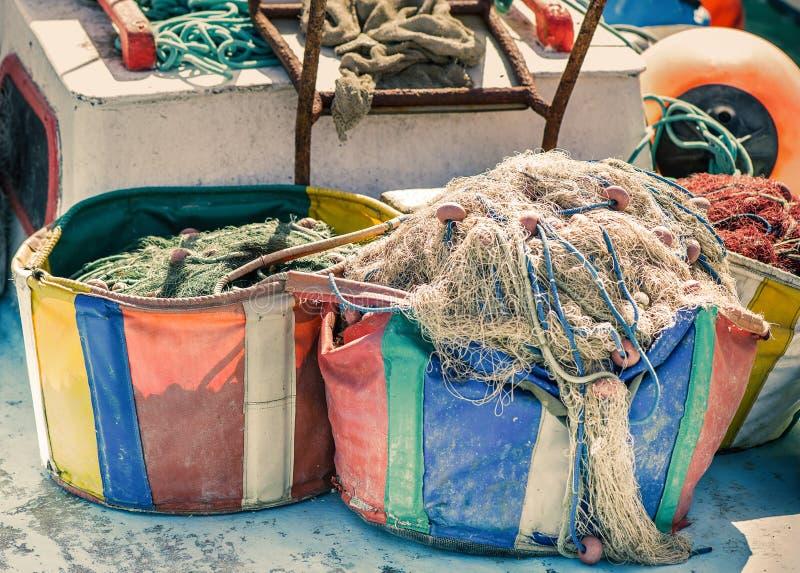 Fishing net in a fishing boat stock photo