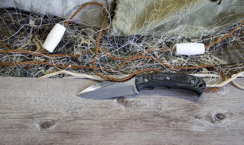 Fishing net with floats. And hunting knife stock photo