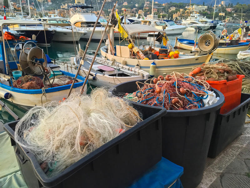 Fishing net, floats, nylon rope used in fishing industry in even. Plastic box full of fishing net, floats, nylon rope used in fishing industry in evening at stock images