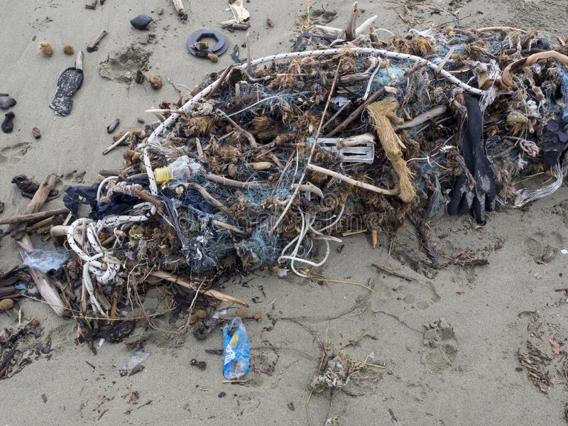 Fishing net full of plastic waste. Symbol fo ocean pollution. Fishing net arrived on the beach full of plastic waste. Symbol fo ocean pollution. Danger fo marine royalty free stock images