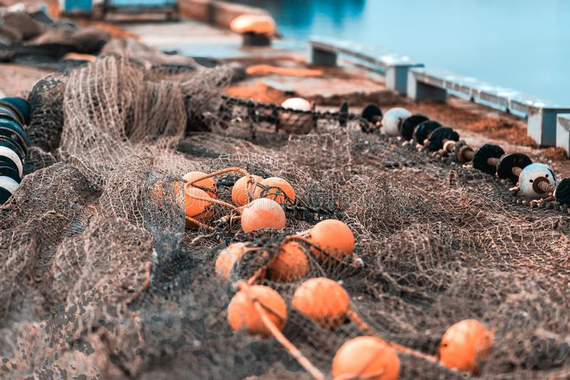 Fishing net with round floats stock images