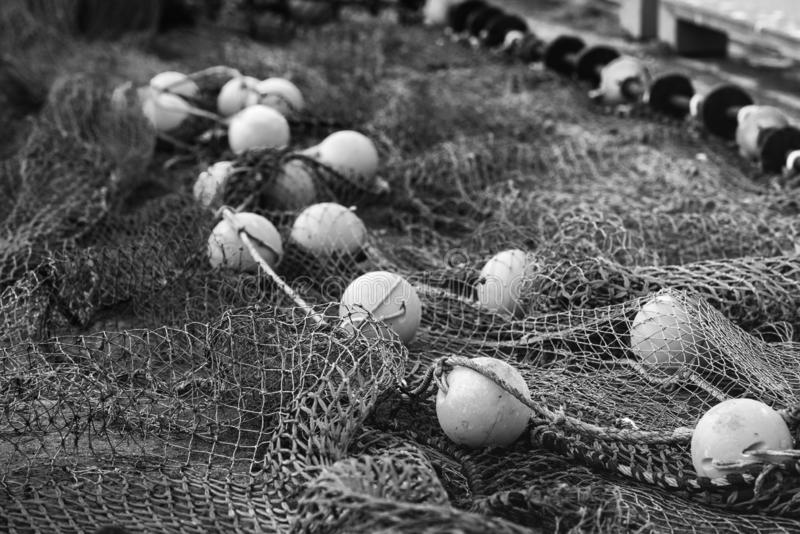 Fishing net with round floats stock photos