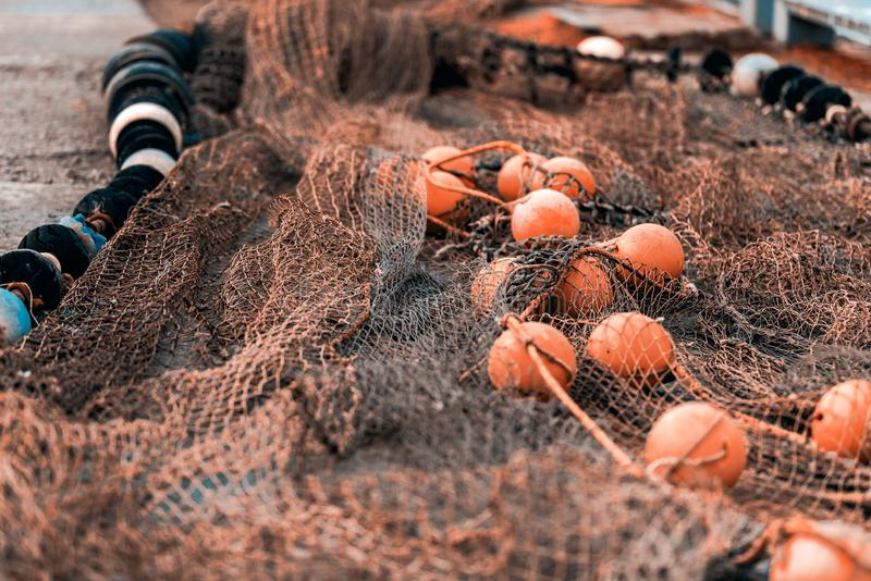 Fishing net with round floats stock photography