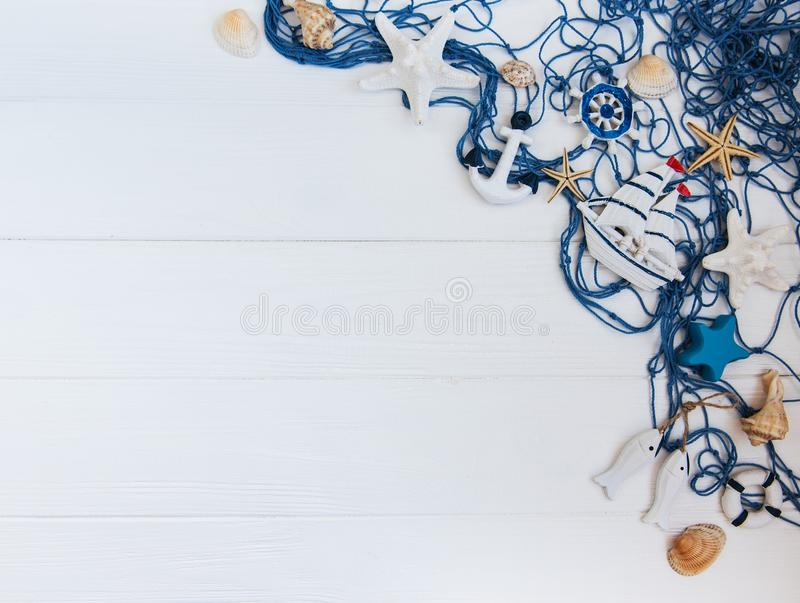 Fishing net with starfish and sea decorations stock photo