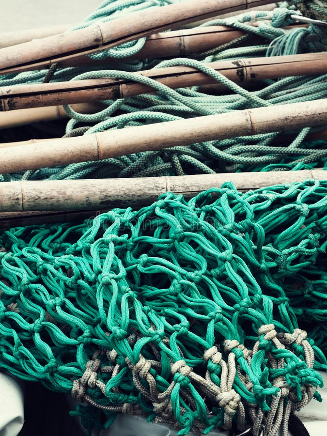 Fishing net and utensils. In a harbour, vintage color stylized stock photography