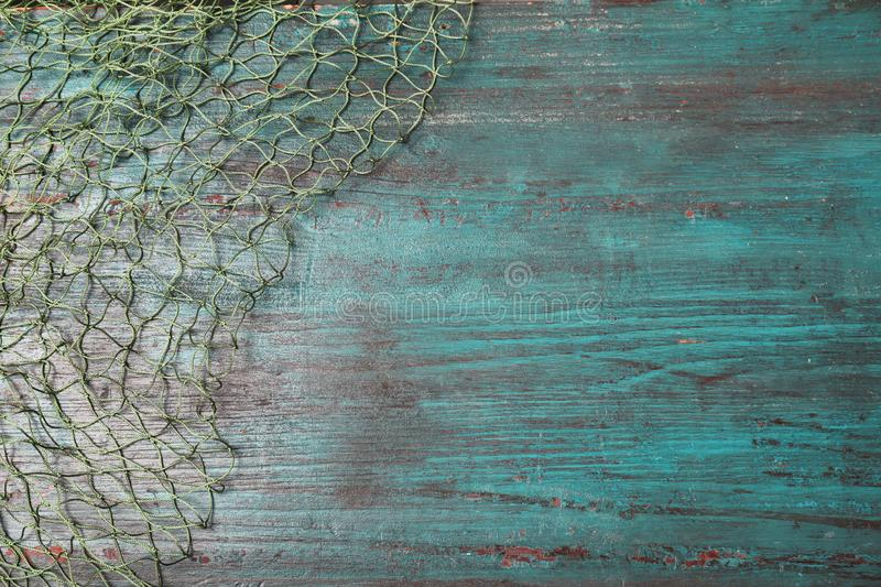 Fishing net on wooden background, top view royalty free stock photo