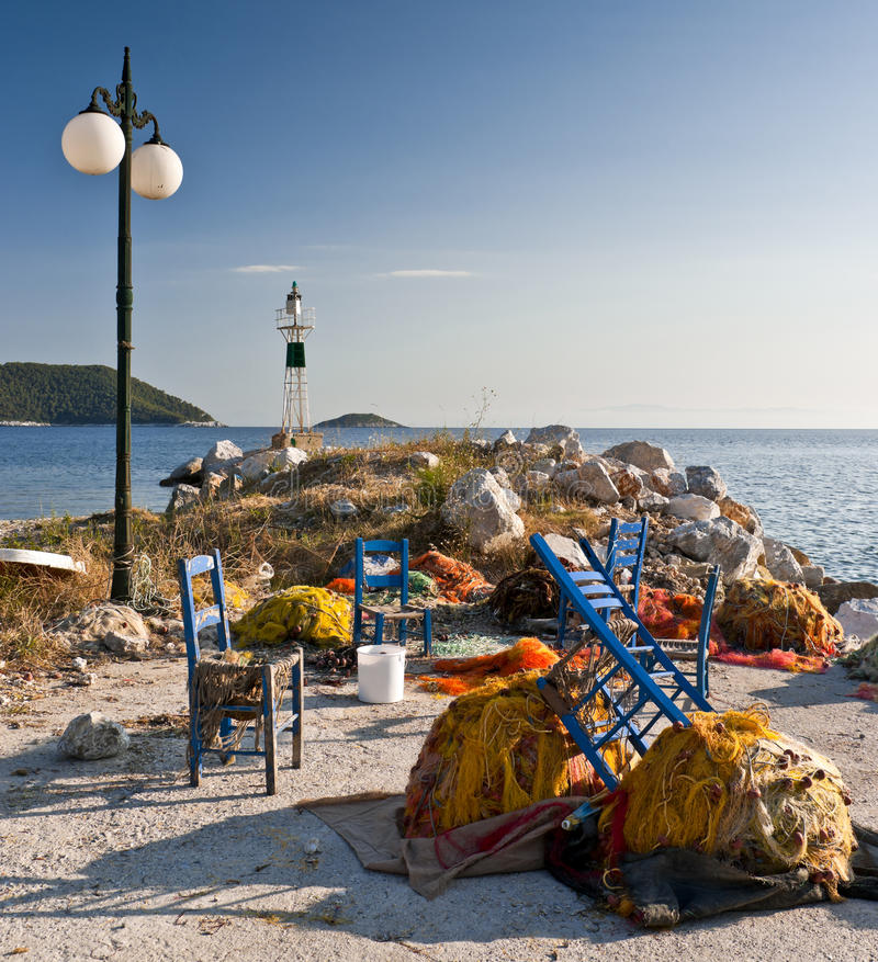 Fishing nets and blue chairs royalty free stock photos