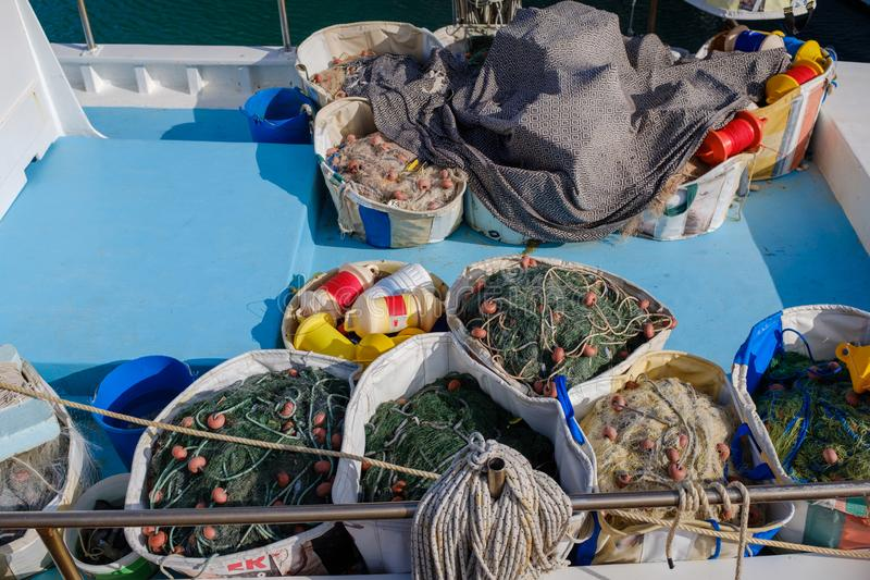 Fishing nets in a boat stock photos