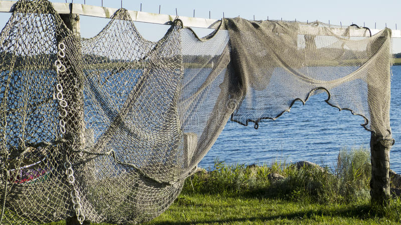 Fishing nets and fish traps stock images