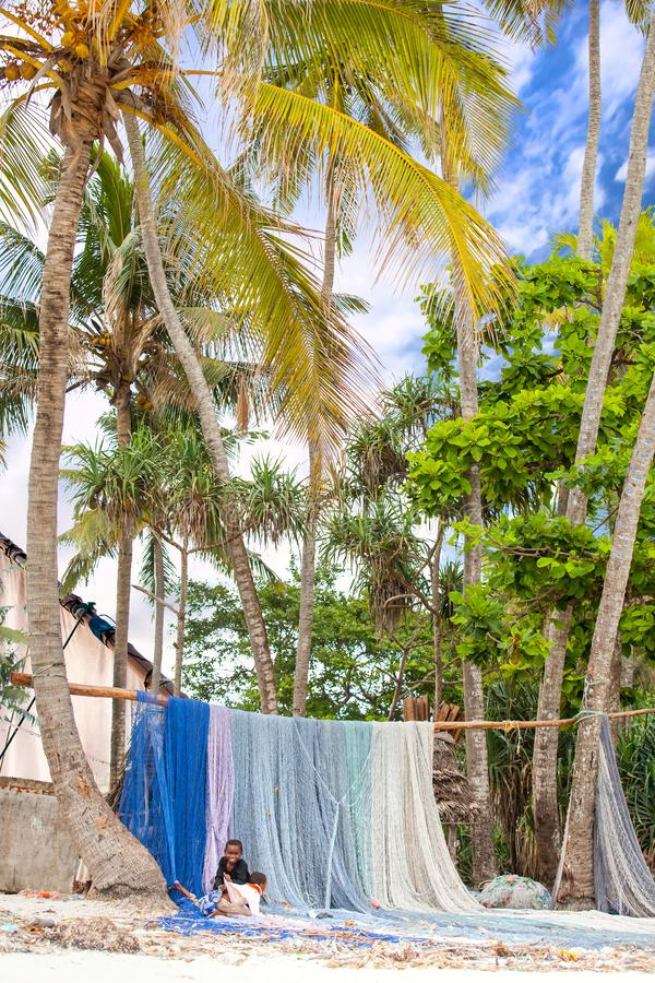 Fishing nets hung up to dry on beachfront. royalty free stock photography