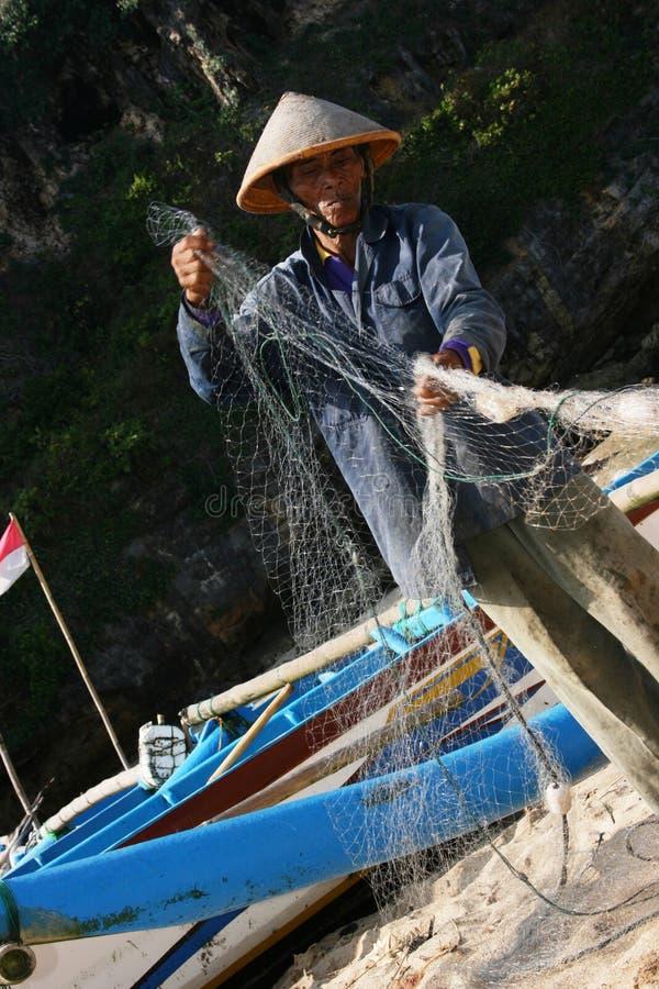 Fishing. Ngrenehan beautiful beach located in wonosari, Yogyakarta, Indonesia royalty free stock image