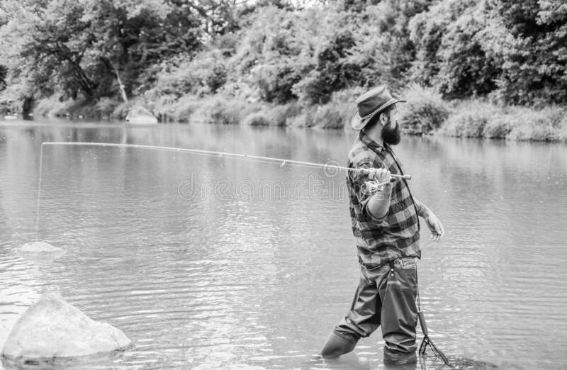 Fishing outdoor sport. Fishing hobby. Teach man to fish. Fly fishing may well be considered most beautiful of all rural. Sports. Fisherman lucky catching fish stock photography