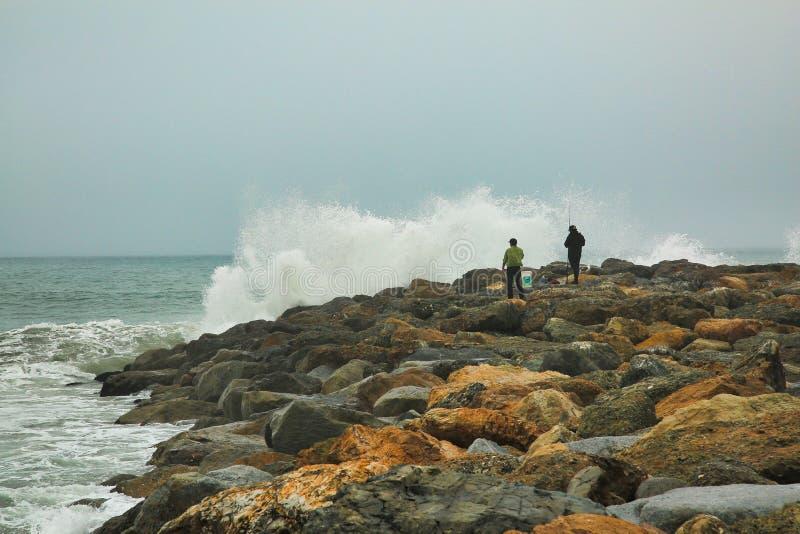 Fishing Oxnard California waves. Large crashing waves over rocks in Oxnard were people go stock photos