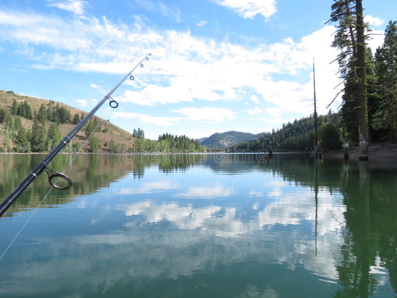 Fishing on Patterson Lake. Reflections on Patterson Lake fishing in Methow Valley, Washington State royalty free stock photos