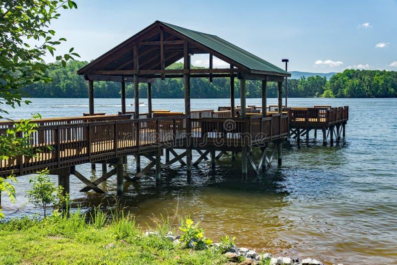 Fishing Pier – Smith Mountain Lake, Virginia, USA. Franklin County, VA – May 29tht: Fishing pier located at Smith Mountain Lake Community Park royalty free stock photo