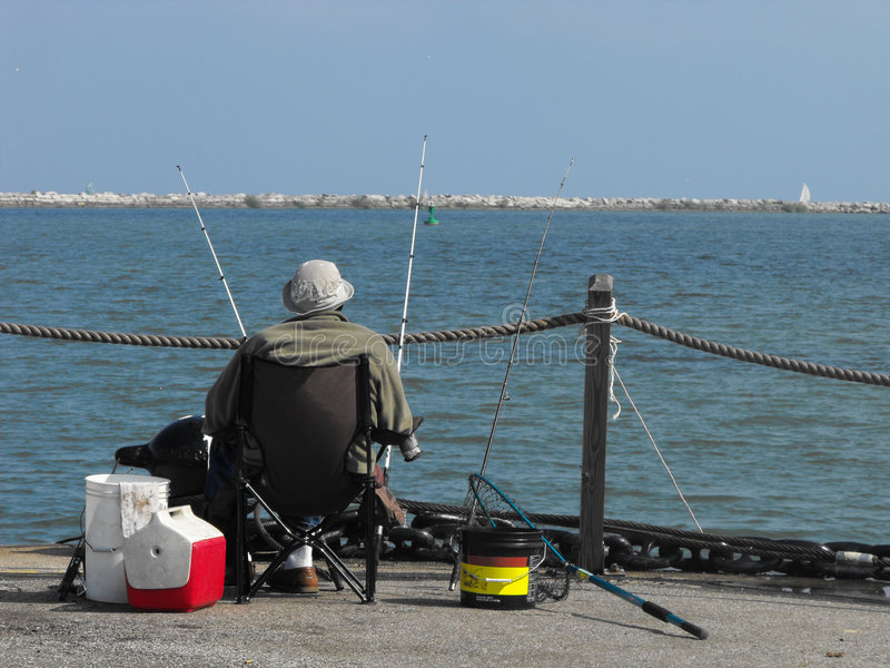 Fishing the pier royalty free stock photography