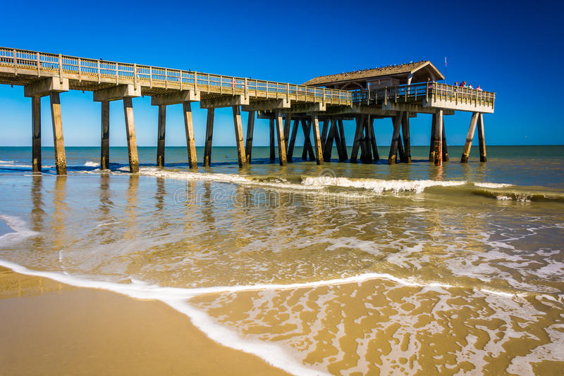 The fishing pier and Atlantic Ocean at Tybee Island, Georgia. The fishing pier and Atlantic Ocean at Tybee Island, Georgia royalty free stock photography