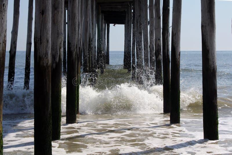Fishing Pier Splash royalty free stock image