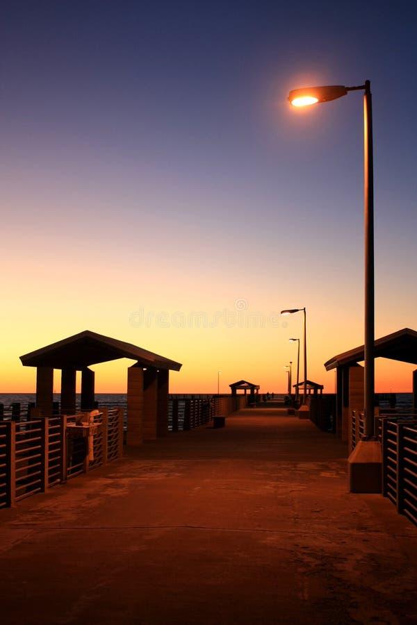 Fishing pier at sunrise stock photos