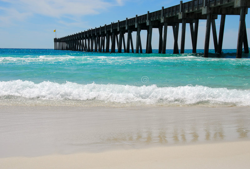 Fishing Pier and Surf stock images