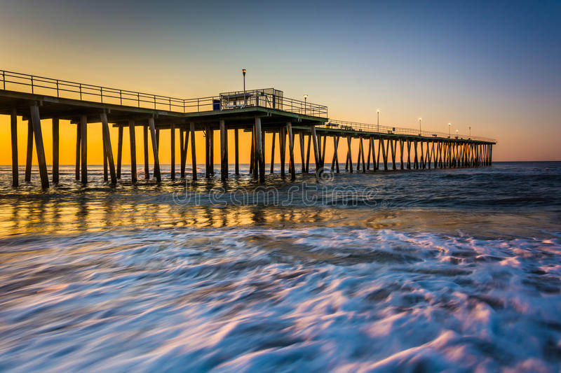 Fishing pier and waves on the Atlantic Ocean at sunrise in Ventnor City, New Jersey. Fishing pier and waves on the Atlantic Ocean at sunrise in Ventnor City stock image