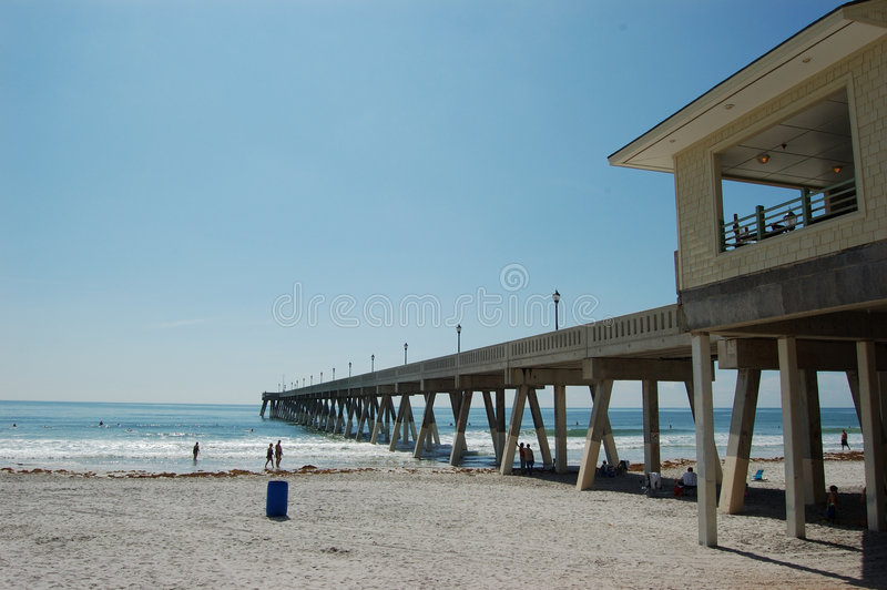 Fishing Pier - Wrightsville Beach NC. Sunbathers relax as the season draws to a close in Wrightsville Beach NC royalty free stock image