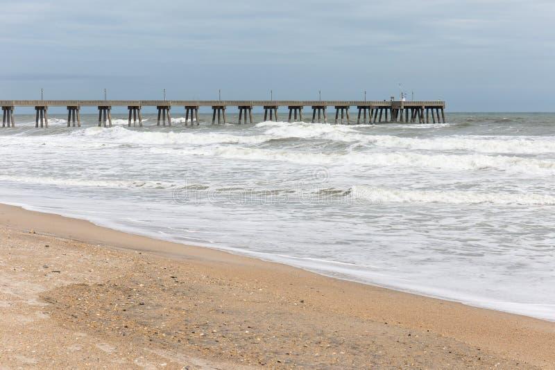 Fishing Pier at Wrightsville Beach, NC. View of fishing pier and heavy ocean surf at Wrightsville Beach, North Carolina, USA stock photography