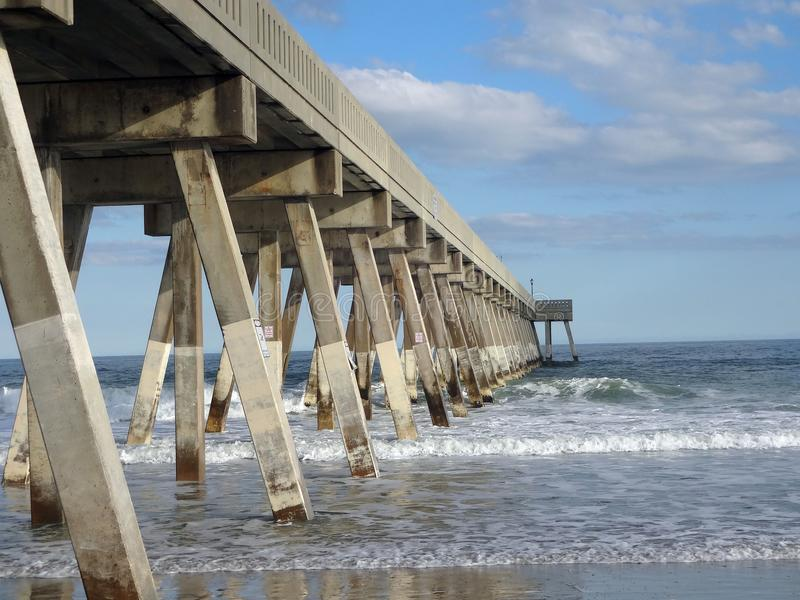 Fishing Pier on Wrightsville Beach, NC. View from under the fishing Pier on Wrightsville Beach just outside of Wilmington, North Carolina stock photography