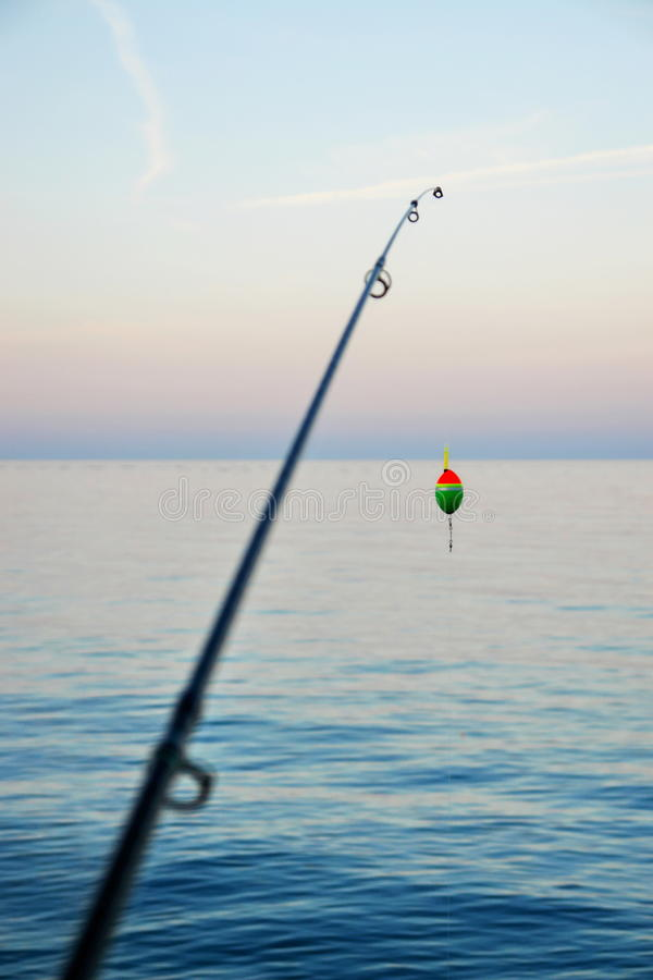 Fishing Pole. Waiting to be cast, with line and sinker stock image