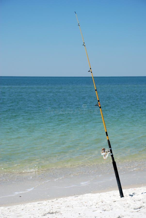 Fishing pole on beach. Fishing pole angled on beach royalty free stock photo