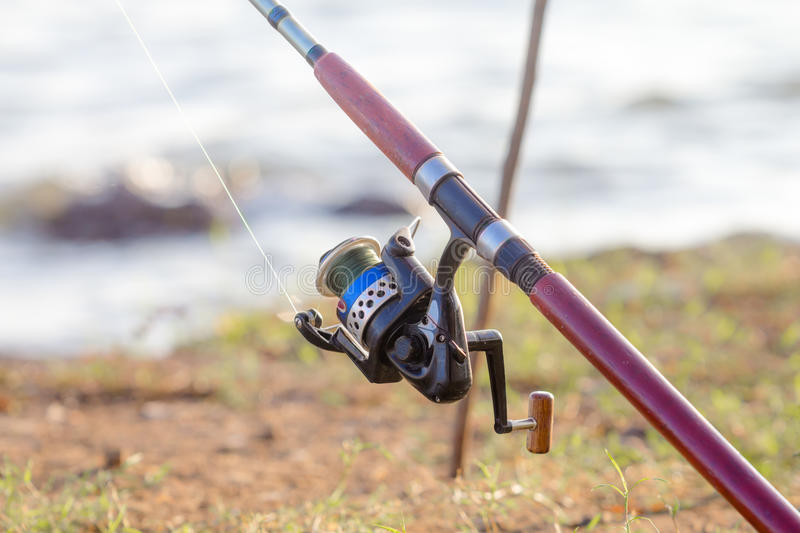 Fishing pole. Close up of fishing pole with spinning royalty free stock photo
