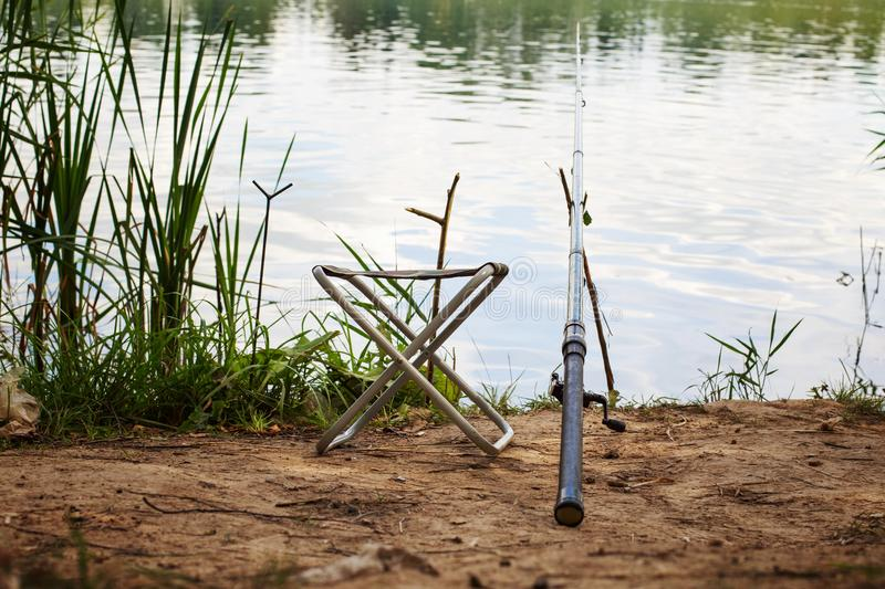 Fishing pole. On the river bank royalty free stock photos